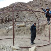 Setting up the dome and tunnel framework... Stanzin Shara and Dadul.