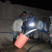 Finally stream water reaches the stupa site. Ice Stupa team measures the discharge.